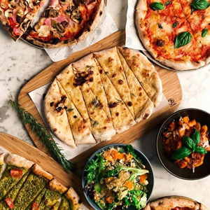 Corbett & Claude's award-winning pizzas are perfect for sharing