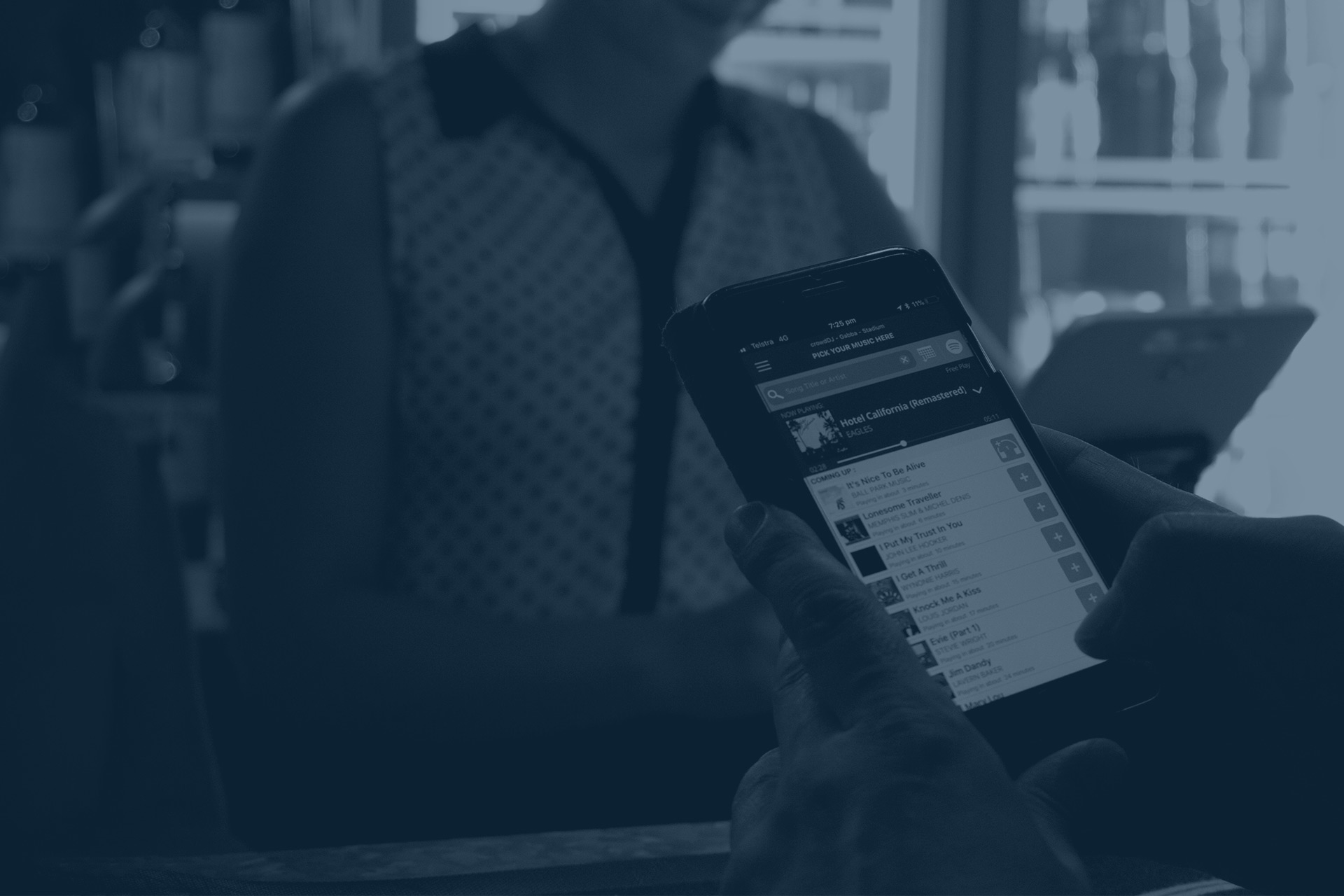crowdDJ - The Jukebox App for Bars - Customers picking their favourite music at Mr Henderson bar